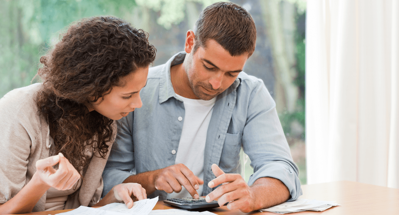 surviving-near-debt-experience-couple-calculating-bills-featured-image.png